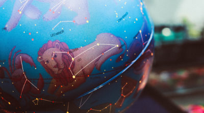 Image of zodiac signs on plastic globe - leo sign in view
