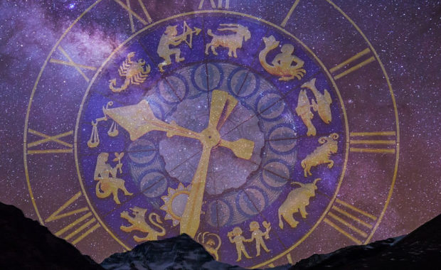 purple & gold clock with all zodiac signs on it - in purple starry sky with mountains