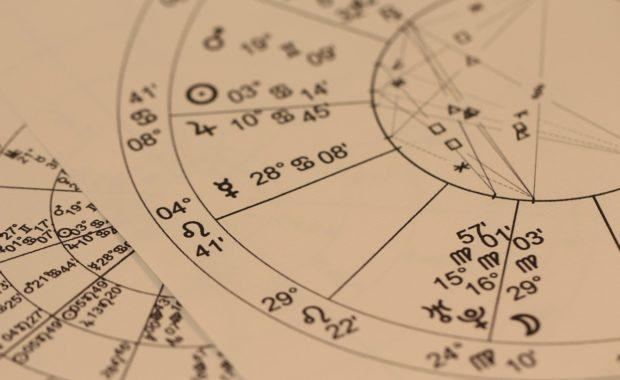zodiac symbols drawn on paper
