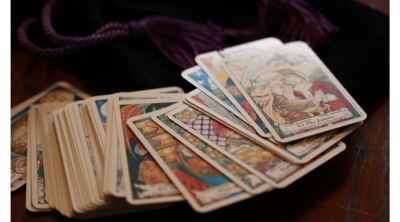 tarot cards spread out on table