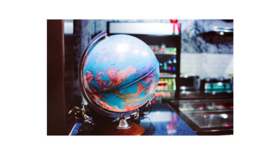 image of blue globe with zodiac signs on it sitting on a table