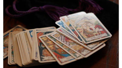 colorful tarot cards spread out on table