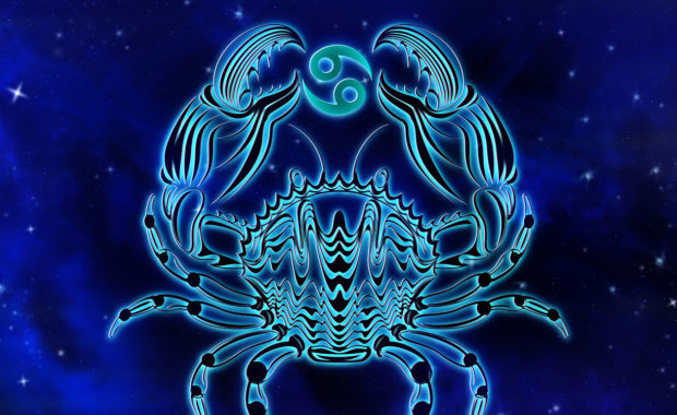 Cancer the crab constellation in the hight sky with the cancer symbolism between it's claws