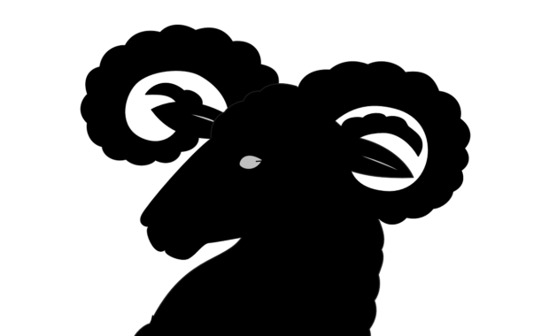 silhouette of a ghost head with curly horns and pointed ears