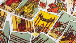 image of green, yellow, and red tarot cards spread out on a table