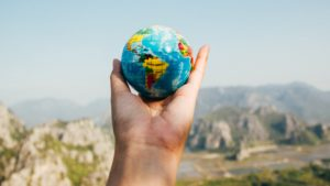 image of a hand holding the globe
